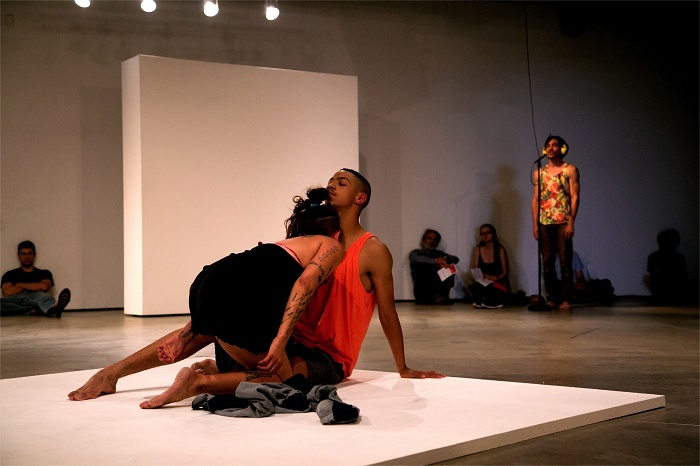 """Performance view, """"Made in L.A. 2014"""" at Hammer Museum, Los Angeles, 2014.  Pictured: Julie Tolentino, Jose Tena, and Nick Duran."""
